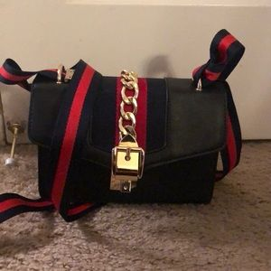 Classy black purse with ribbon and gold chain